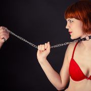 beautiful woman in the role of a slave on a leash